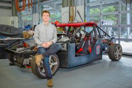John Alsterda with the X1, an autonomous experimental car that was designed and built by Stanford PhD students.